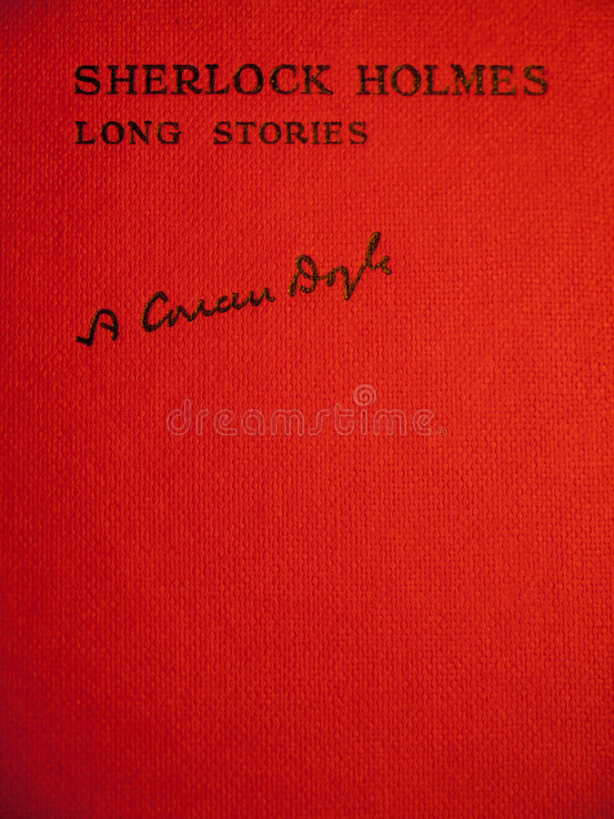 Front cover of sherlock holmes long stories. Red bound front cover of an aged copy of sherlock holmes long stories carrying title and signature of sir arthur stock image