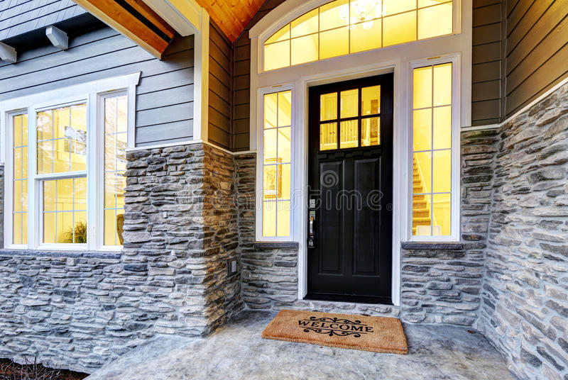 Front covered porch design with stone columns stock photos