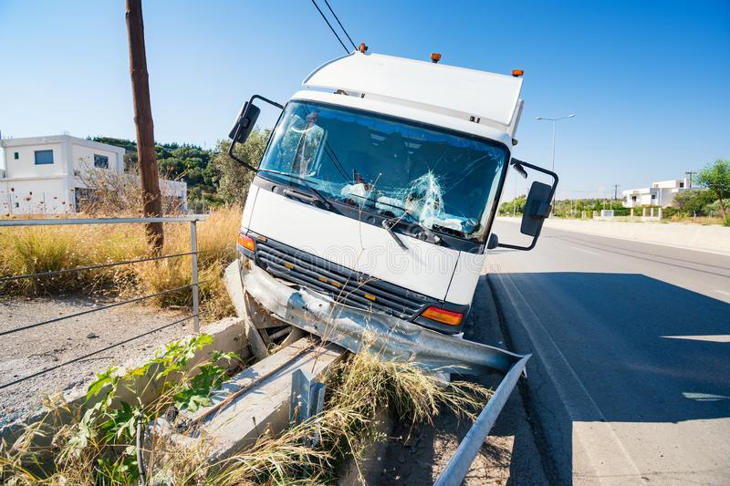 Front of crashed truck that hit crashed barrier on the road, bro stock photo