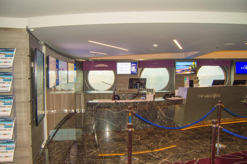 The front Desk of a cruise ship overlooking the tour Desk MSC Meraviglia, October 8, 2018. The front Desk of a cruise ship overlooking the tour Desk MSC stock photography