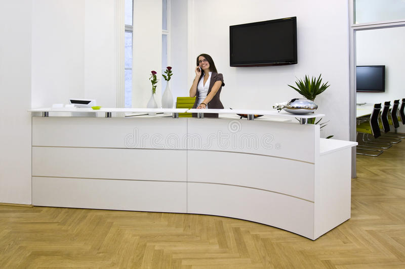 Front desk lady. A front desk lady doing her job very well and cheerfully