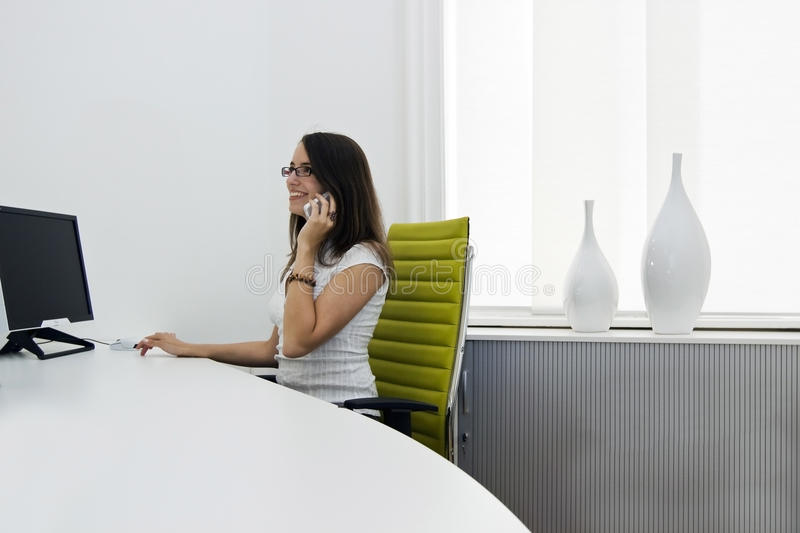 Front Desk Lady Royalty Free Stock Images