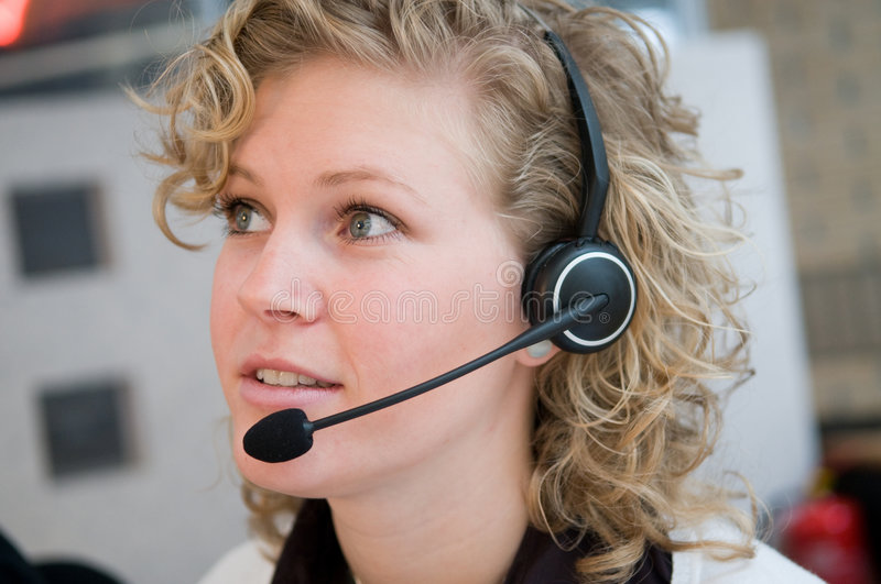 Front desk worker. Receptionist or frontdesk worker in an office stock photography