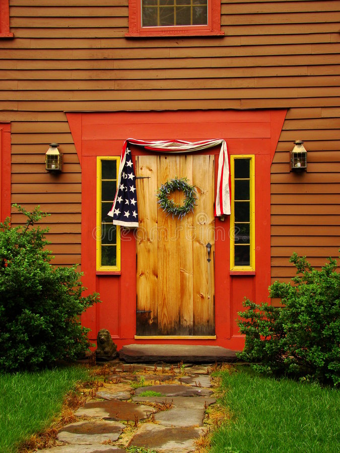 Front Door. A front door and decor on an old colonial home royalty free stock image