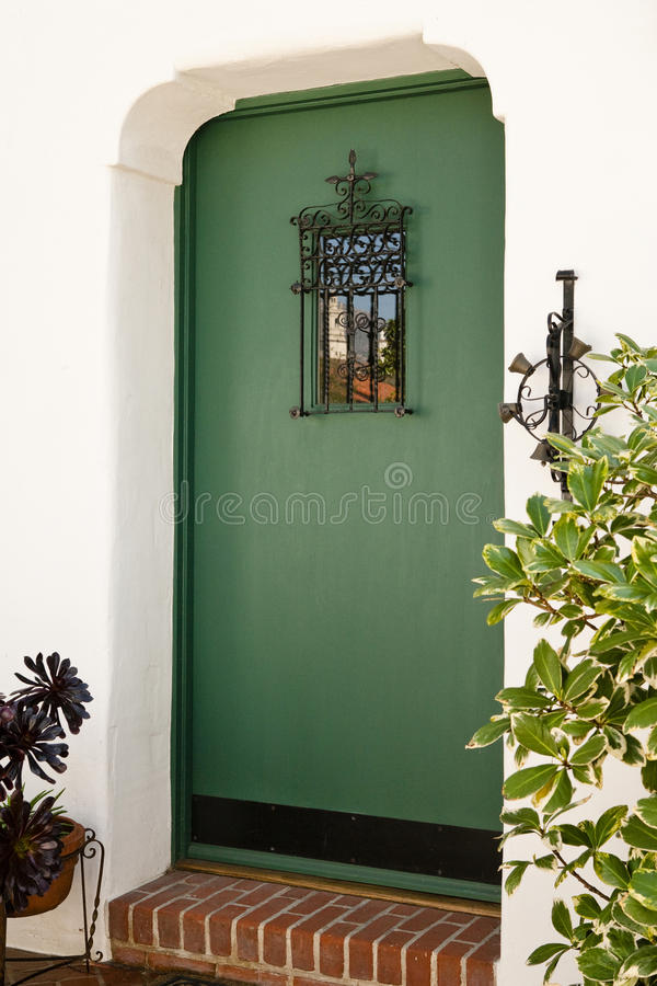 Front Door of aHome. Exterior view of a front door to a residence with a reflection in the window royalty free stock photography