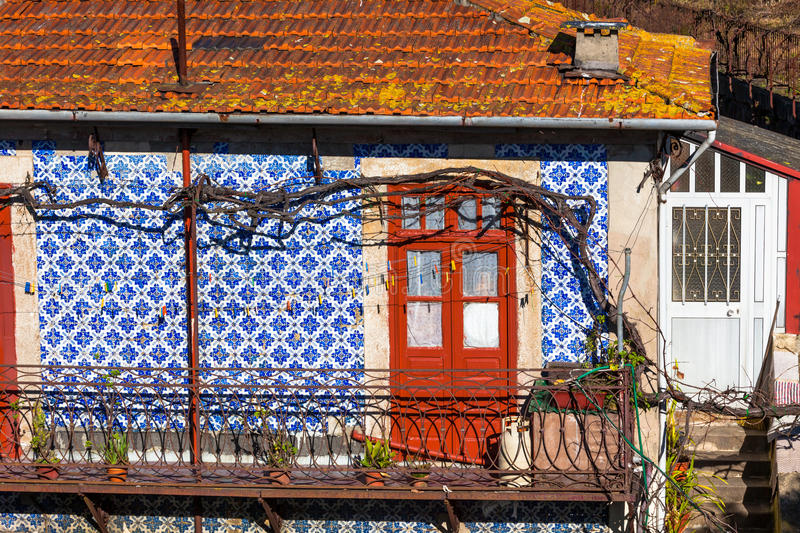 Front Door and Azulejo Wall of Old House in Porto. Bright Front Door and Azulejo Wall of Old House in Porto, Portugal stock image