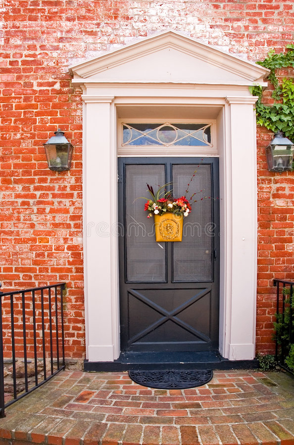 Front Door of Brick House - 3. Main entrance and door to an old brick house in a small, rural community stock photos