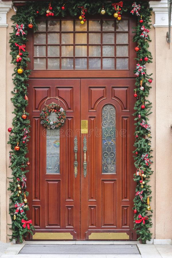 Front door with a Christmas wreath. Christmas decorations stock photography