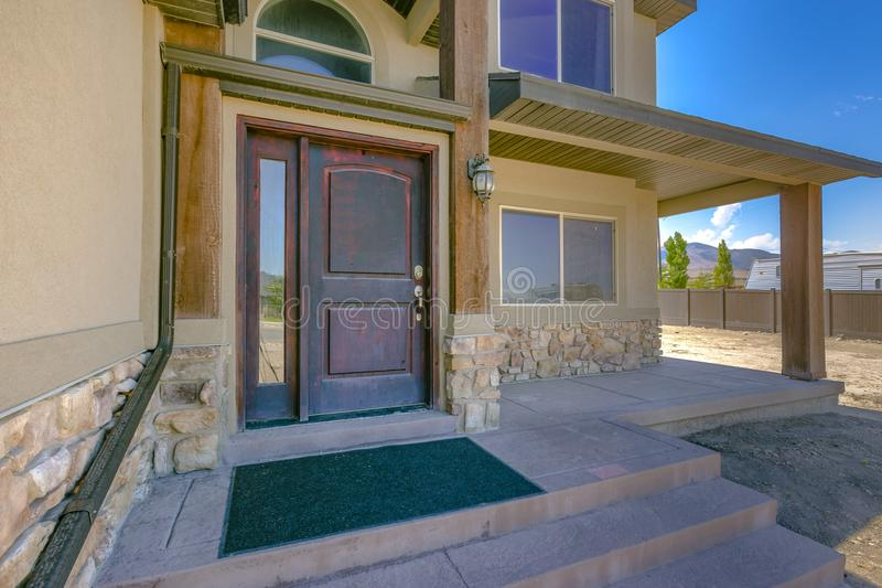 Front door entry of home with no landscape. The entrances and front door of homes in the greater Salt Lake City and Utah Valley area royalty free stock image