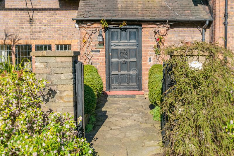 Front door and exterior of a typical English residential old London town house royalty free stock photography