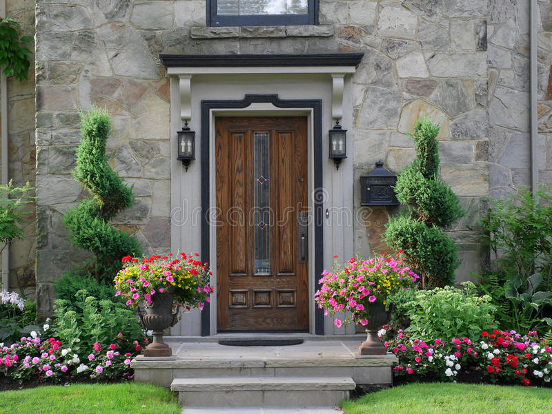 Front door with flowers. Suburban house stock photos