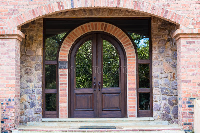 Front door home arch stone wood stock photo image of for Arch door design