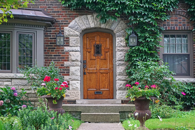 Front door of house with ivy royalty free stock photography