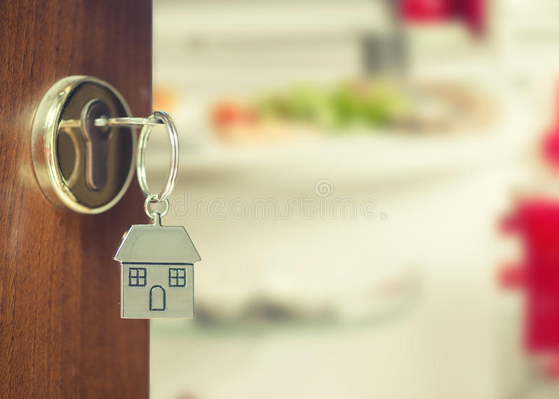 Front door with house keys with chain key. Front door with house keys with internal wiew royalty free stock image