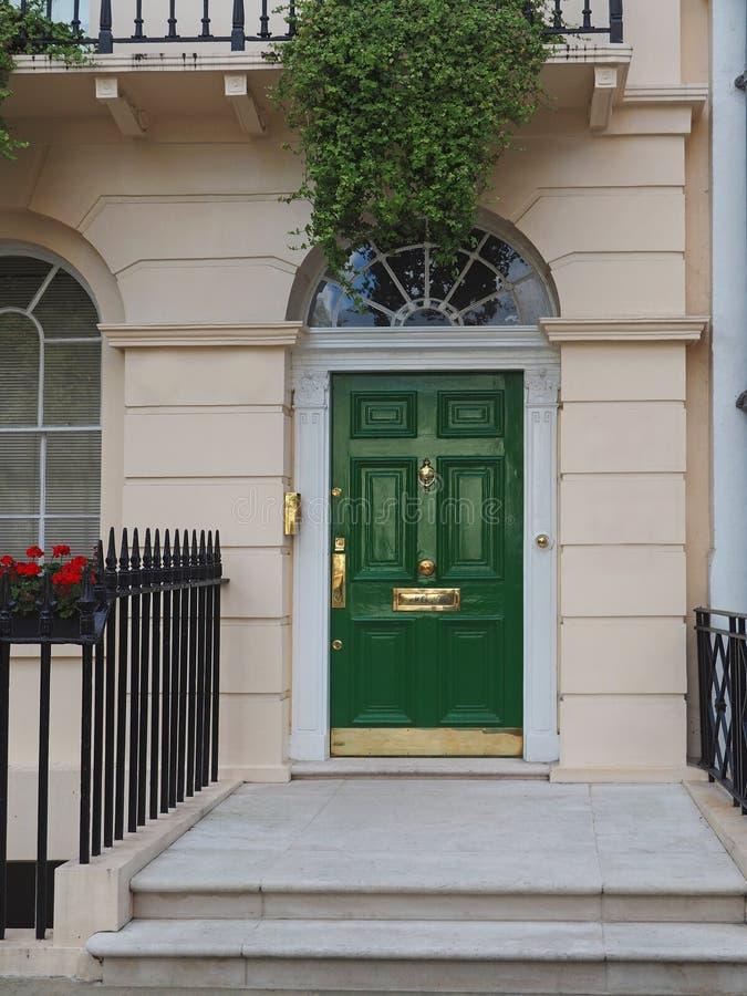Front Door Of London Townhouse Stock Image - Image of plant, door ...