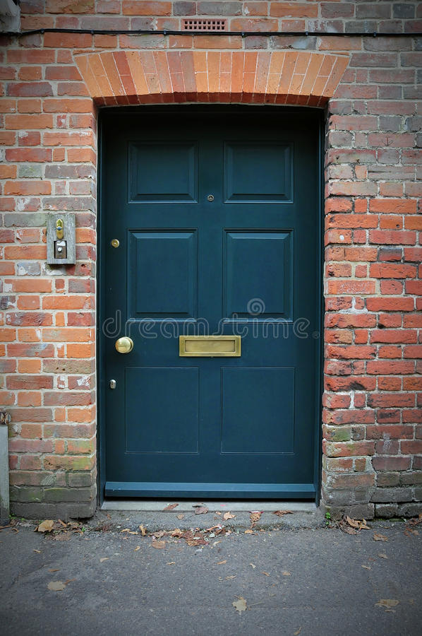 Free Front Door Of A Red Brick House Royalty Free Stock Photos - 21225938