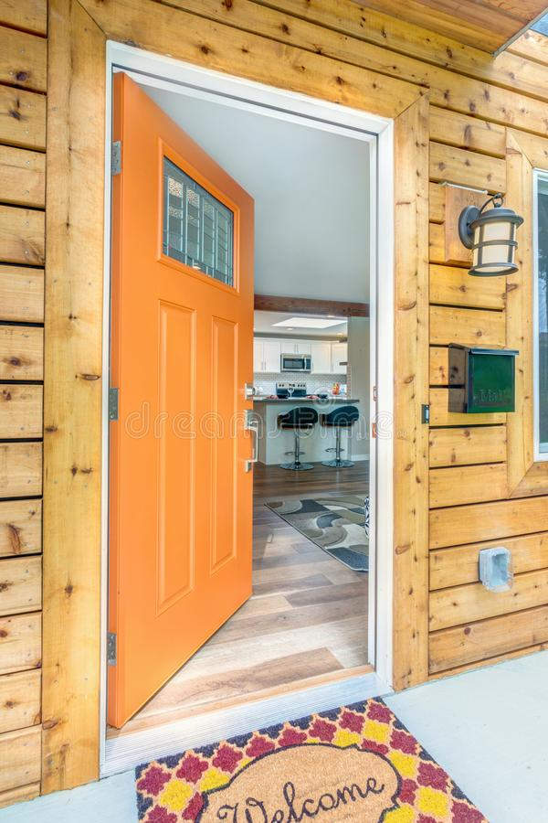 Front door opens into a kitchen. royalty free stock photos