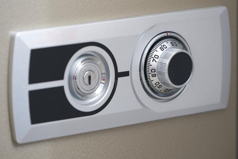 Front door of safe,dial mechanic and key hole for open royalty free stock photos