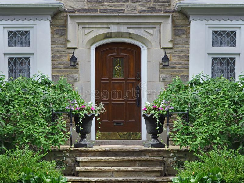 Front door of stone faced house stock image