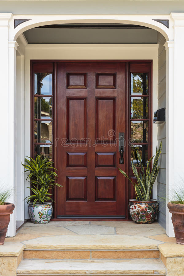 Free Front Door, View Of Front Door Accented With Plants Royalty Free Stock Images - 74011879