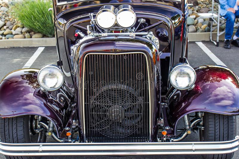 Front End Grill Of Hot Rod Automobile. Front End Grill & Chrome Engine With Carburetors Of Hot Rod Automobile royalty free stock photos