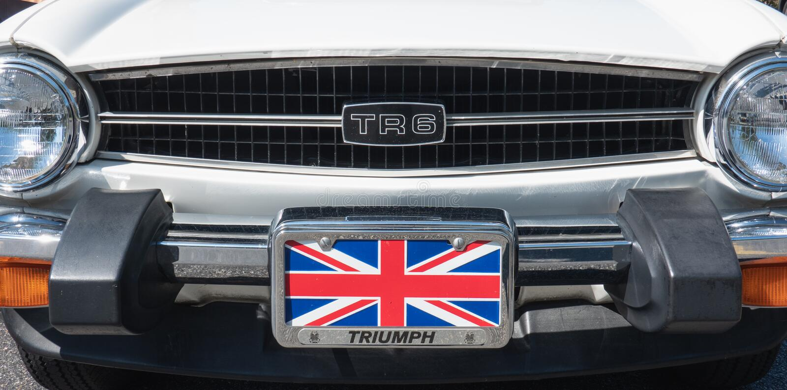 Front end and grille of a white Triumph TR6. West Chester, PA - August, 11, 2019: Close up of the front end and grille of a white Triumph TR6 with the British royalty free stock photo
