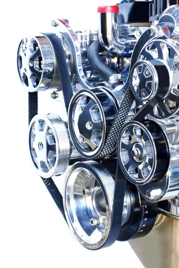 The front end of a high performance chrome engine. Showing the alternator and serpentine belt stock photography