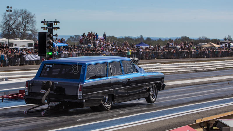 Front End Lift. Redding, California: The front end of a hot rod lifts in the air as the car gets the green light on a start at the drag races stock photos