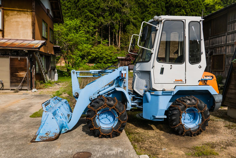 Front end loader in Shirakawa-go. Shirakawa-go, Japan - May 2, 2016: Front end loader in Shirakawa-go in Shirakawa-go. Shirakawa-go is one of Japan's UNESCO royalty free stock photography