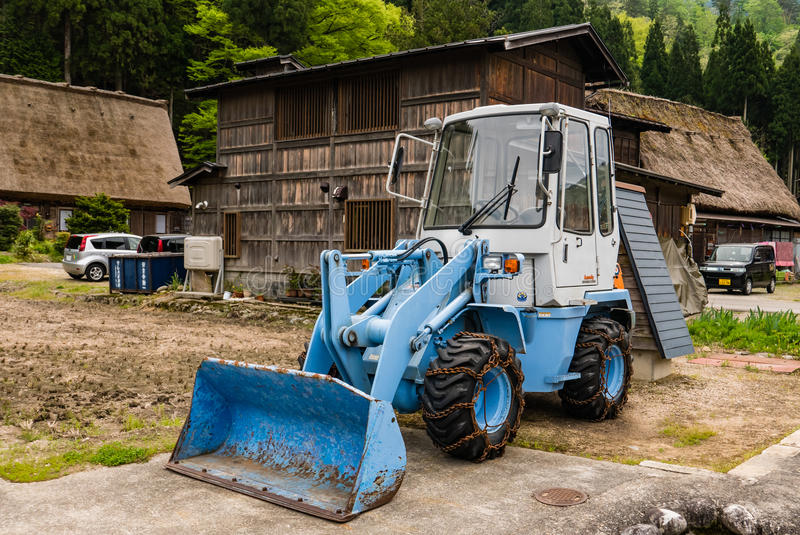 Front end loader in Shirakawa-go. Shirakawa-go, Japan - May 3, 2016: Front end loader in Shirakawa-go in Shirakawa-go. Shirakawa-go is one of Japan's UNESCO royalty free stock photos