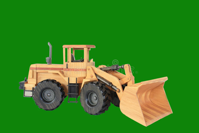 Front End Loader. A wooden model of a front end loader on a green background royalty free stock photos