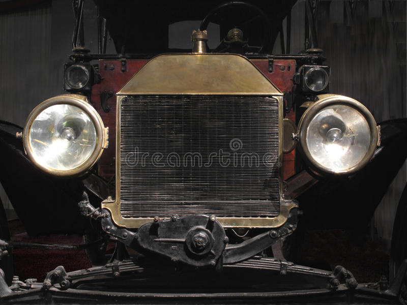 Antique Brass Car Headlights : Front end of a vintage car stock image view