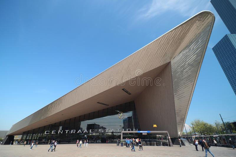 Front entrance of the international train station of Rotterdam named Centraal station in wide angle. stock photos