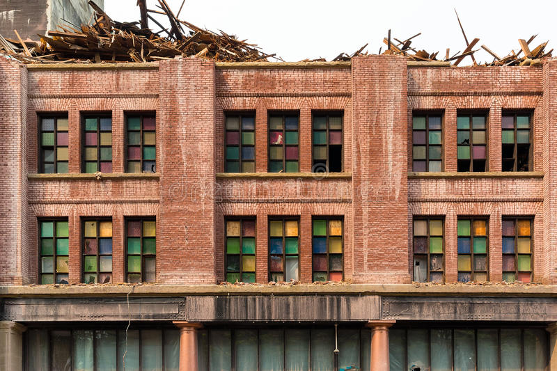 Front Facade of Old Building being Demolished in downtown Porland OR royalty free stock photo