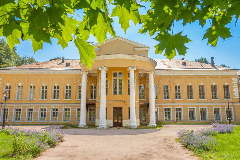 The front facade of the Palace in the manor Sukhanovo. In summer stock photography