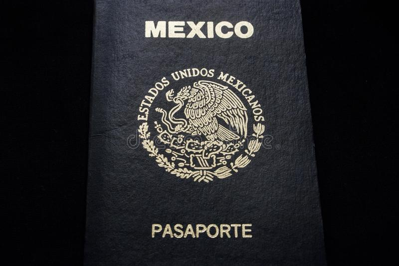 Mexican passport in a black background. Front face of a Mexican passport. Black background royalty free stock photos