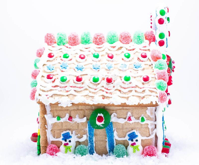 Front Facing Gingerbread House with snowman and Gumdrops stock photo
