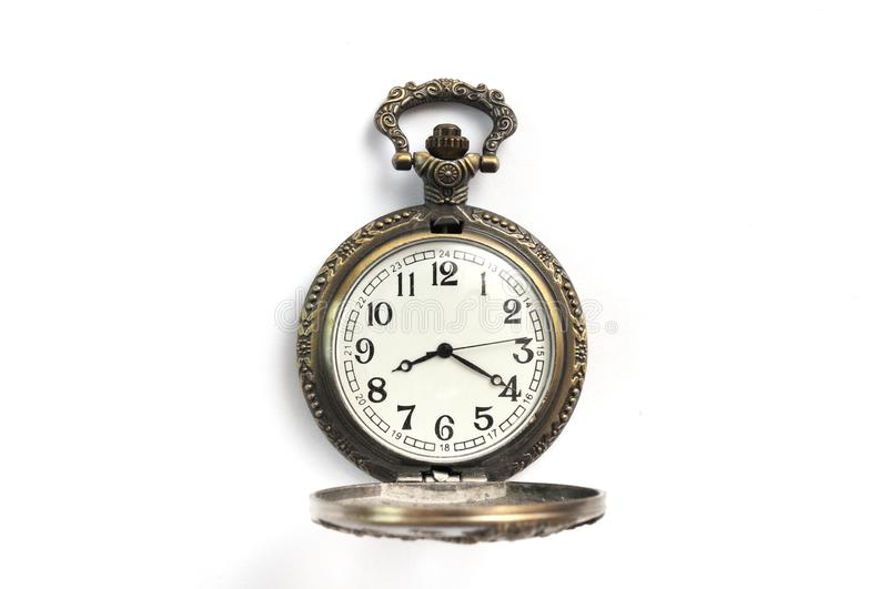 A brown colored carved pocket watch royalty free stock images