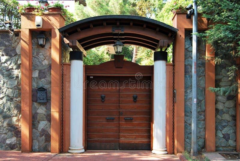 Front garden gate. Decorative wooden front garden gate stock photo