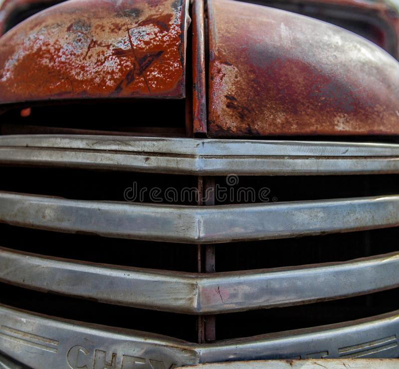 Front Grill of an old chevy truck with patina and character stock photos