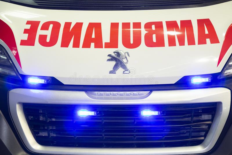 Front grill on Peugeot Commercial Ambulance vehicle with blue lights stock image