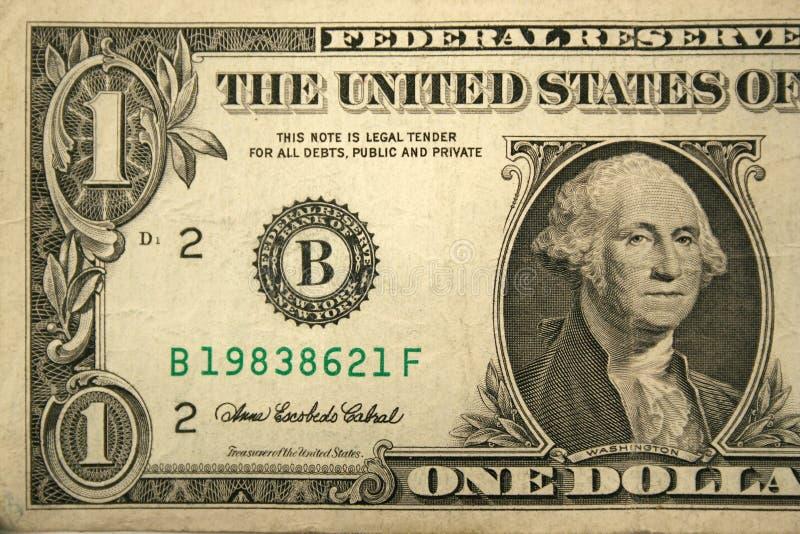 Front Half one dollar bill stock photos