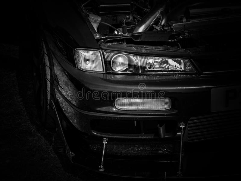 The front headlight of a Japanese sports car royalty free stock image