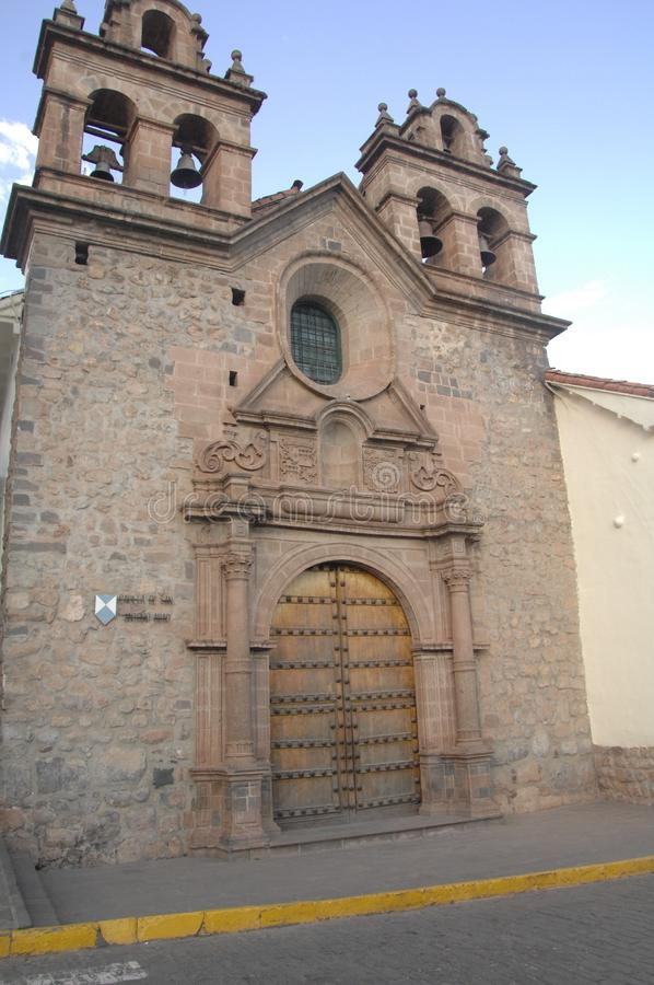 Stone church, Cusco, Peru. Front of historic stone church with bell towers in UNESCO World Heritage site Cusco, Peru stock photos