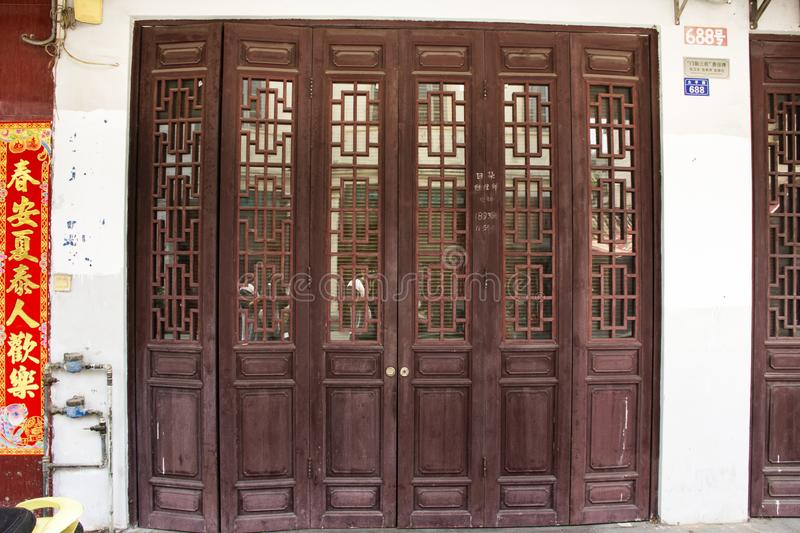Front of house chinese style with retro wooden door and antique wall and vintage decoration of home in old town at Chaozhou stock images