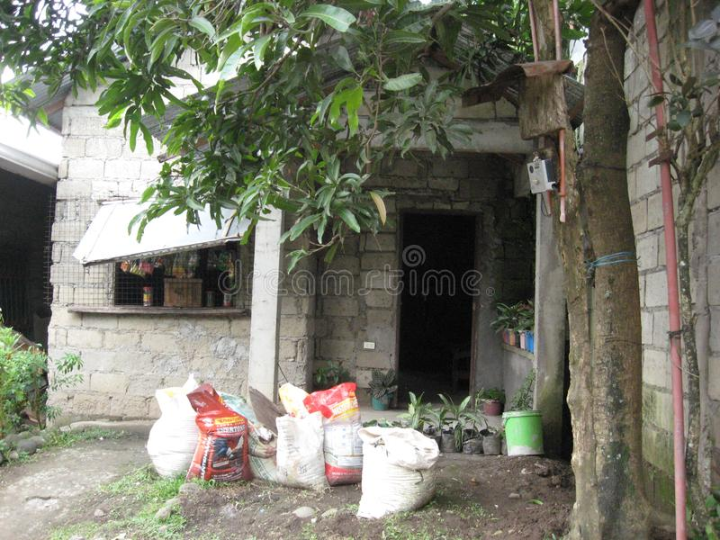A house with small shop in Lipa city, Philippines. The front of a house with small shop in Lipa city, Luzon province, Philippines royalty free stock photo