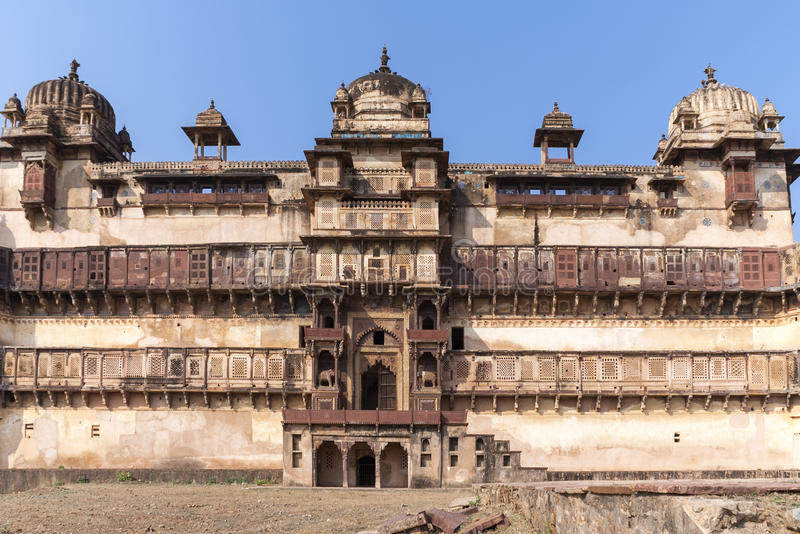 Front of Jehanghir Mahal Palace in India's Orchha. Domed and multi windowed brown beige structure against deep blue skies stock photo