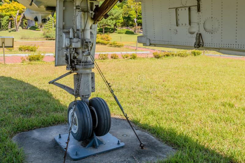 Front landing gear and bay door. On jet fighter on display in public park royalty free stock photo