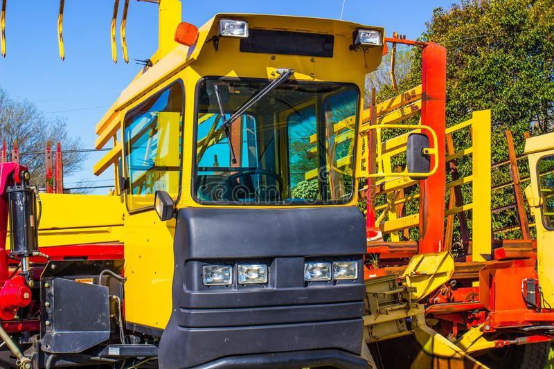 Front Of Large Vehicle With Cab. Front Of Large Industrial Vehicle With Drivers Cab On Sunny Day stock photo