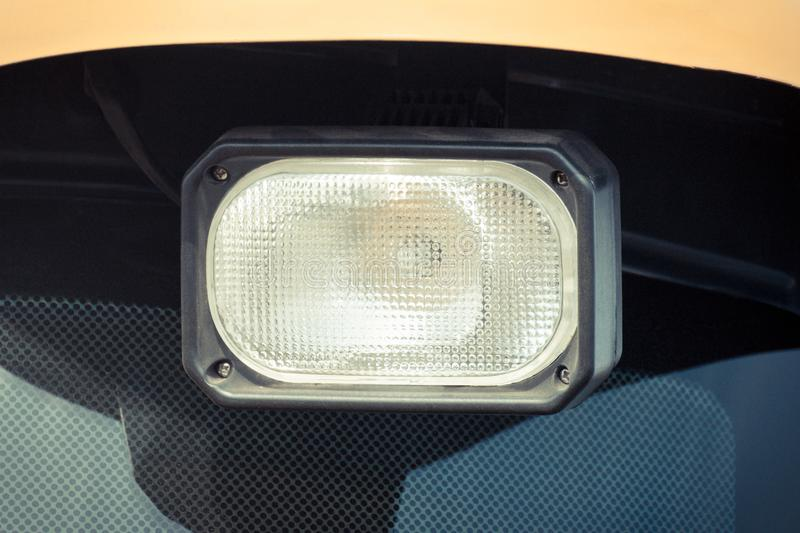 Front light of car, tractor or agricultural industrial machine. Front light of car, truck, tractor or agricultural industrial machine, detail and part of vehicle stock photo